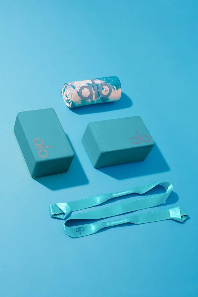 Alo Yoga Home Studio Set with yoga strap, yoga blocks, yoga towel in bright aqua turquoise tie dye.