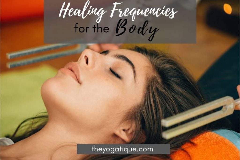 Woman receiving healing sound therapy with tuning forks