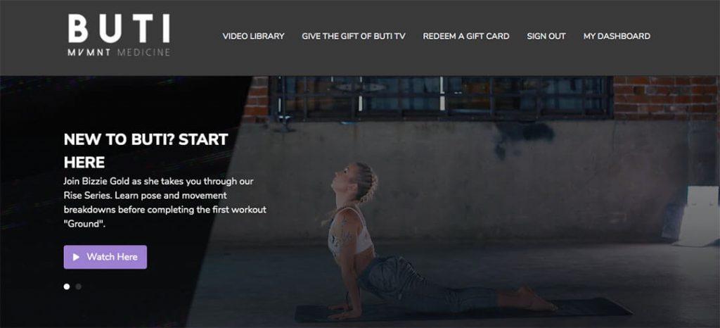 Bizzie Gold the founder of Buti Yoga doing upward facing dog yoga pose on the Buti Yoga Website.